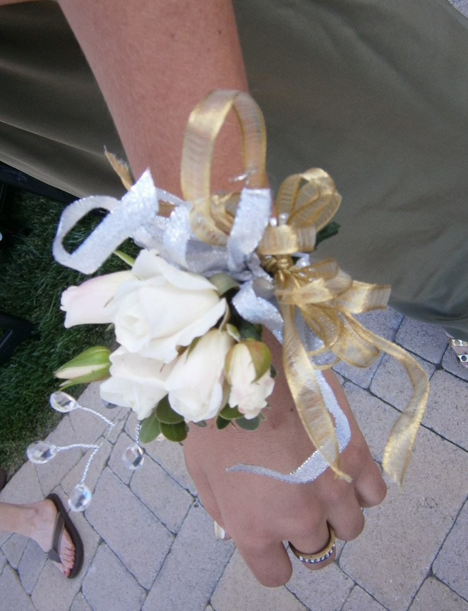 Delicate white roses paired with silver and golden ribbon with crystals.