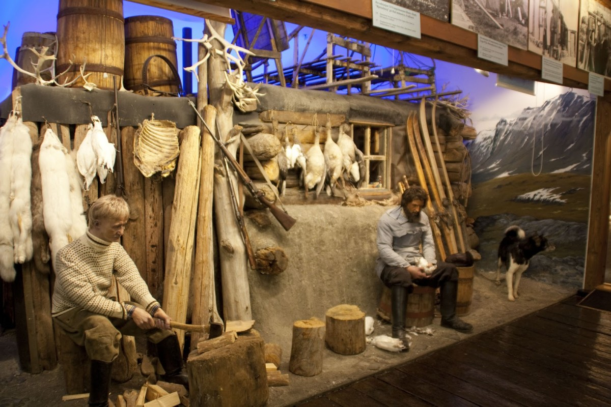 Arctic life displayed at Polar Museum: Family and their home with catch