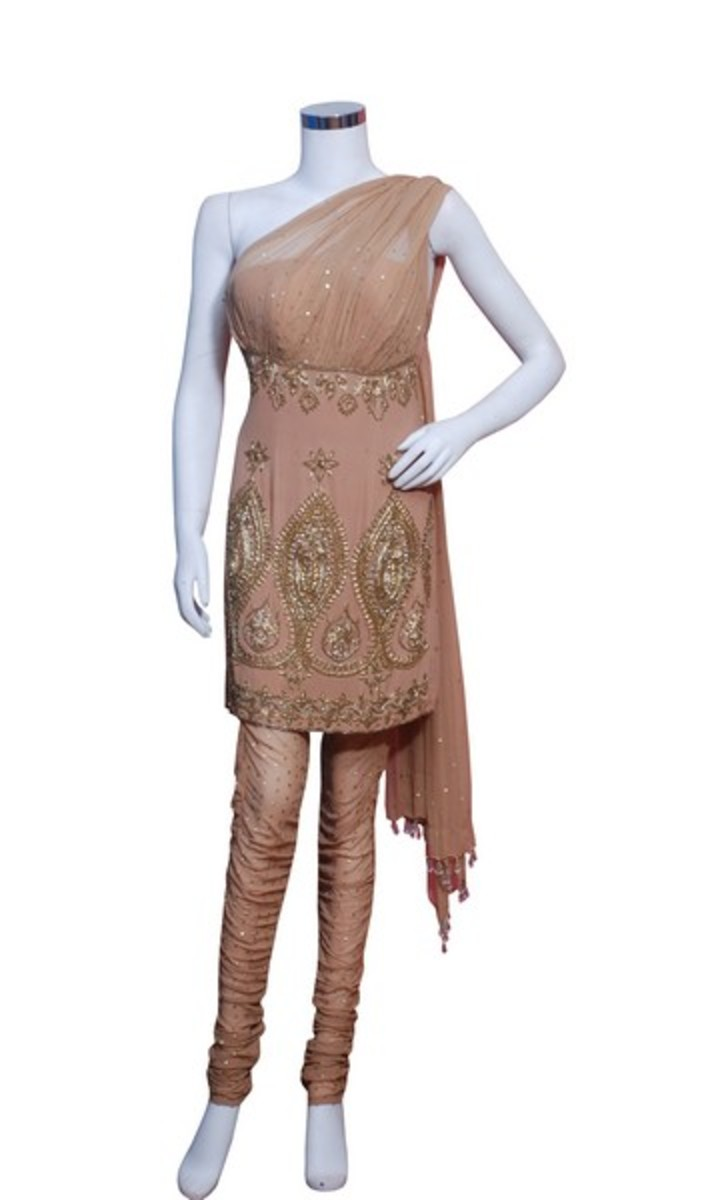 This is a new Kameez design. It is a one shoulder kameez that has the dupatta/urna hanging from one shoulder at the back. This is definitely a show stopper design.