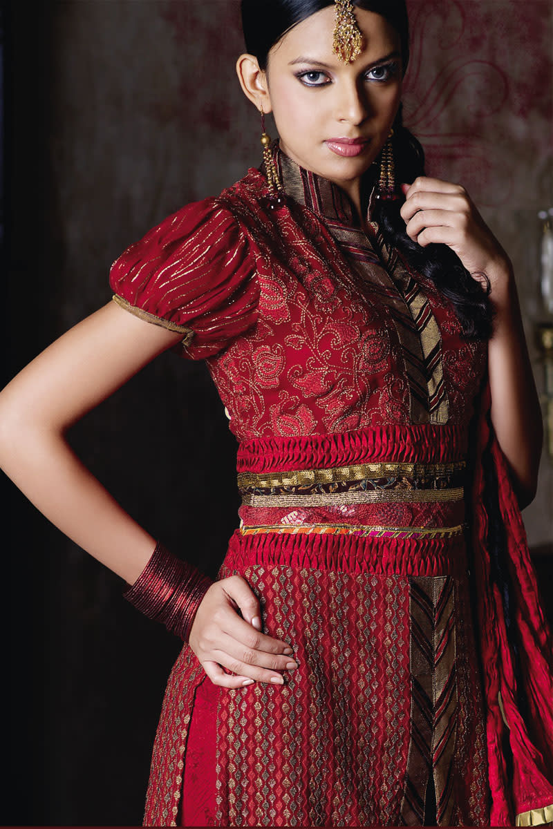 Red Puff sleeve salwar kameez. This type of design makes a female look very cute and playful.