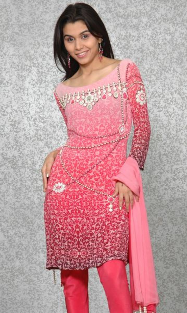 A beautiful pink salwar kameez with jewels used for embellishments.