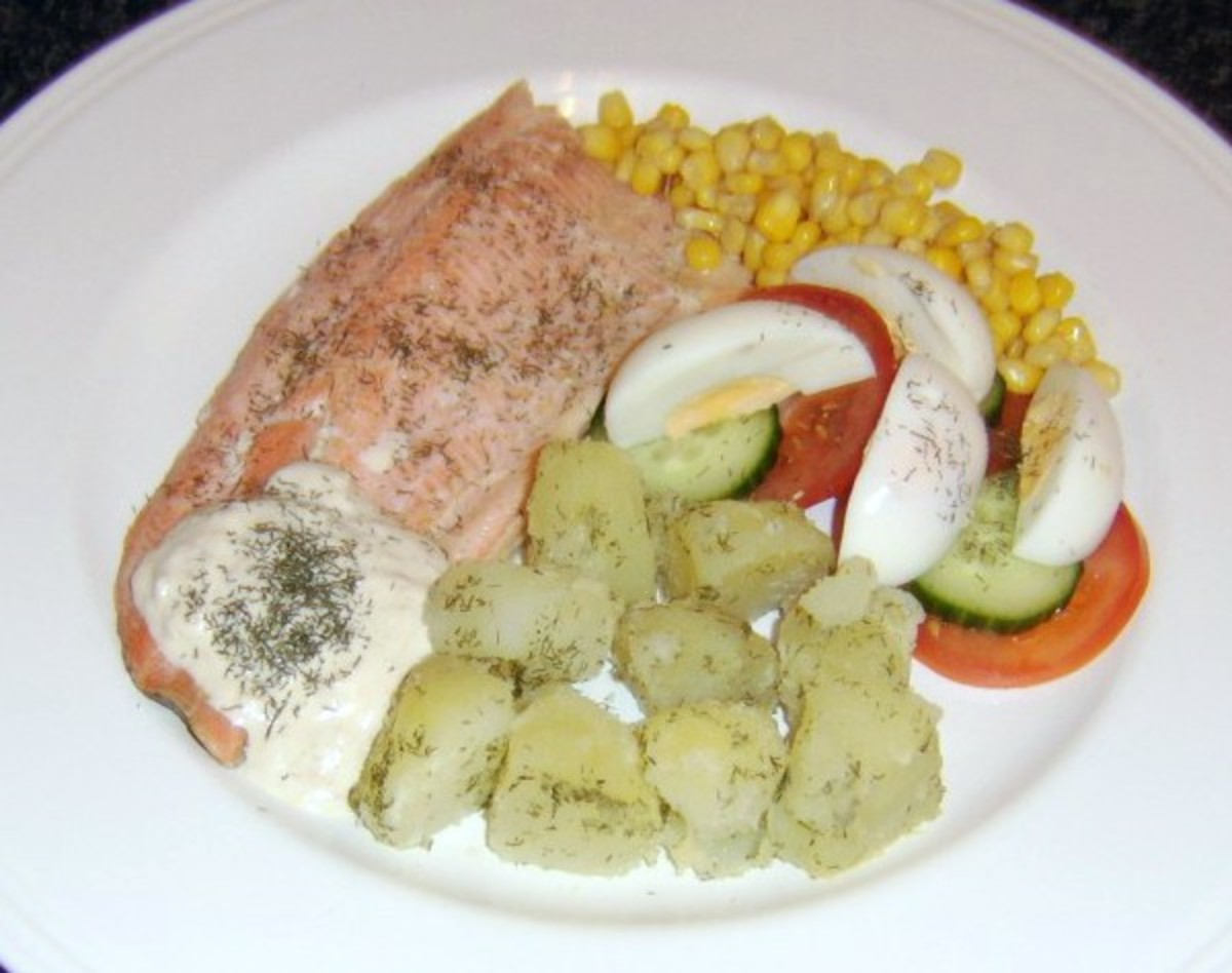 Baked fillet of rainbow trout with dill buttered potatoes and horseradish sauce