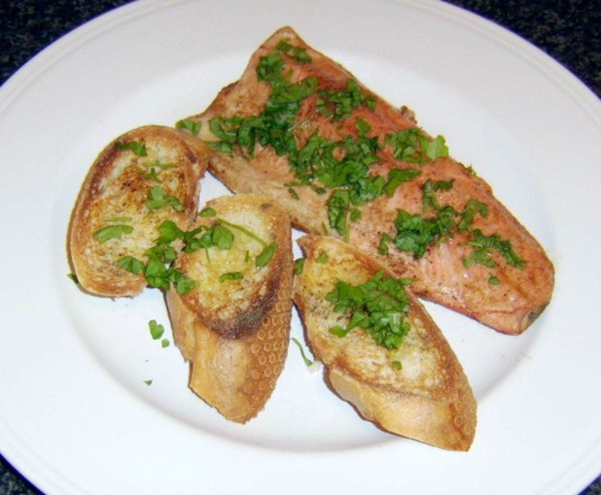 Pan fried rainbow trout fillet is served with bruschetta