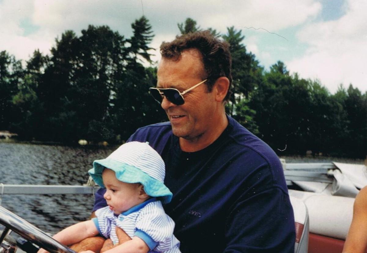 Hubby and Grandbaby On The Lake