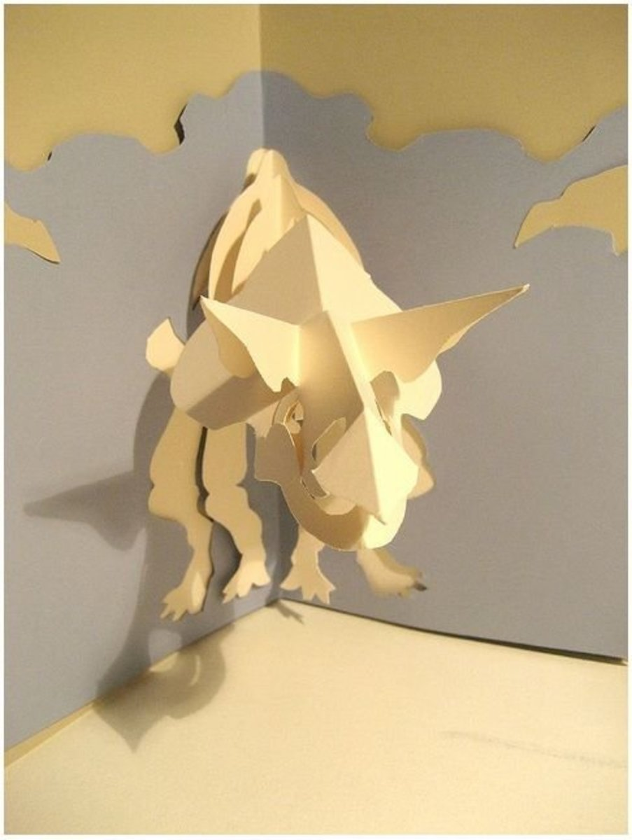Dinosaur kirigami. Kirigami = a combination of paper folding and paper cutting techniques.