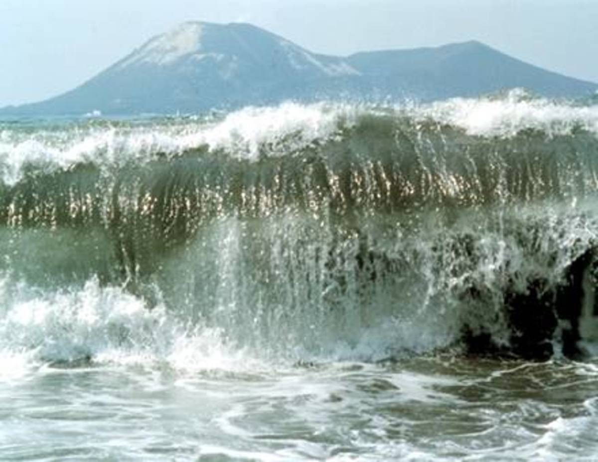 A giant tsunami tidal wave like the one that engulfed Sicily breaks on the shore