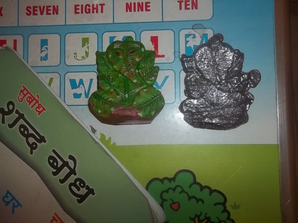The green Ganesha in the left is what I used in the mold and the right one is the final output I produced of the waste lead pieces