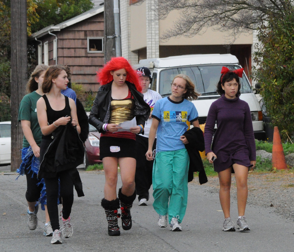 These Seattle teens are mostly appropriately dressed...minus the mini-skirt in the middle. Plus, most of these costumes look home-made and therefore will save $$.