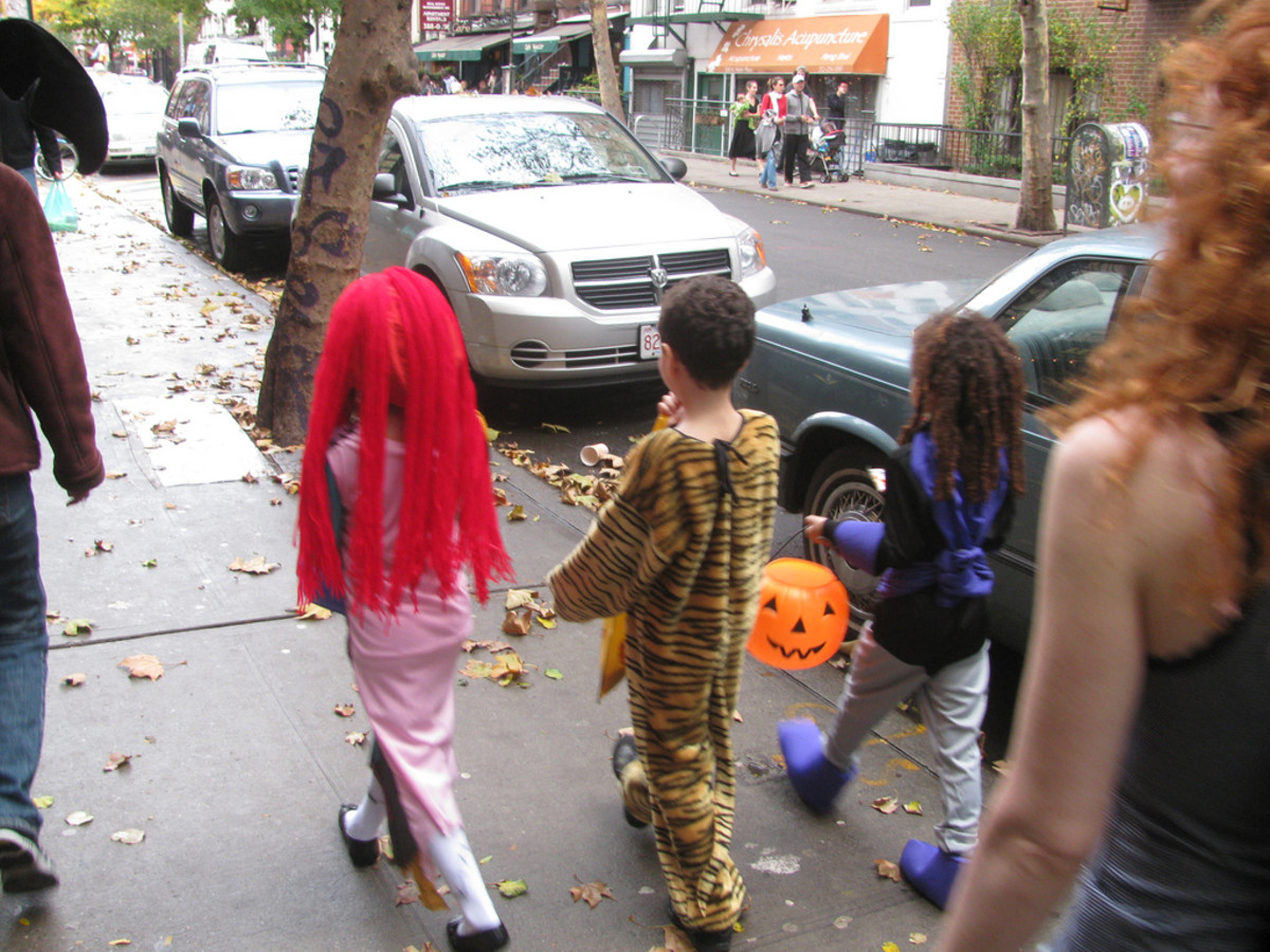 These kids are cute and age-appropriately dressed for Halloween.