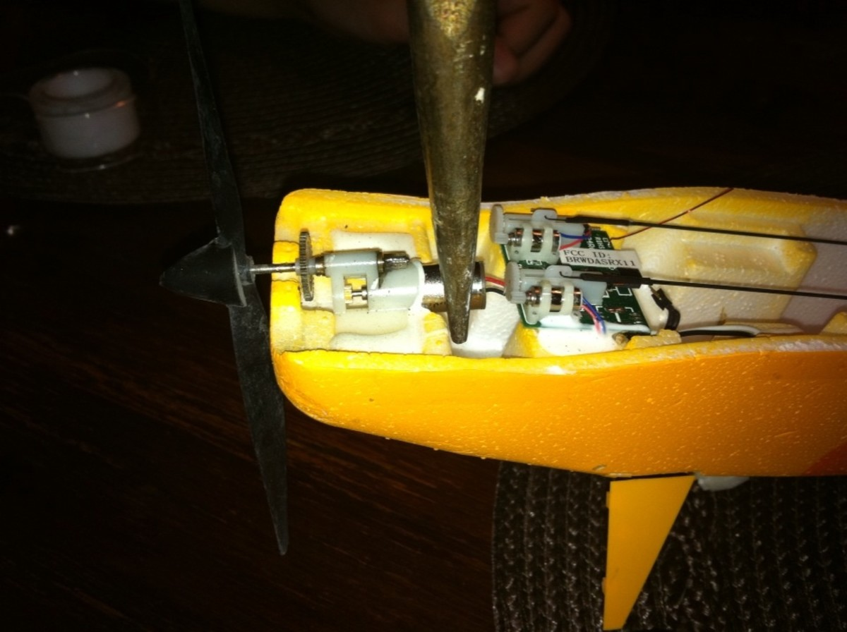 After cutting the foamy glue, use a pair of needle nose pliers to GENTLY pull the motor from the housing.