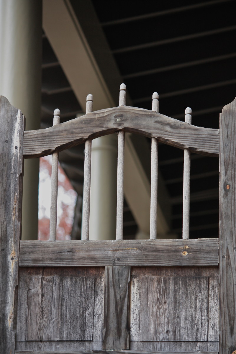 An old gate added to a more modern porch makes for a rustic feel