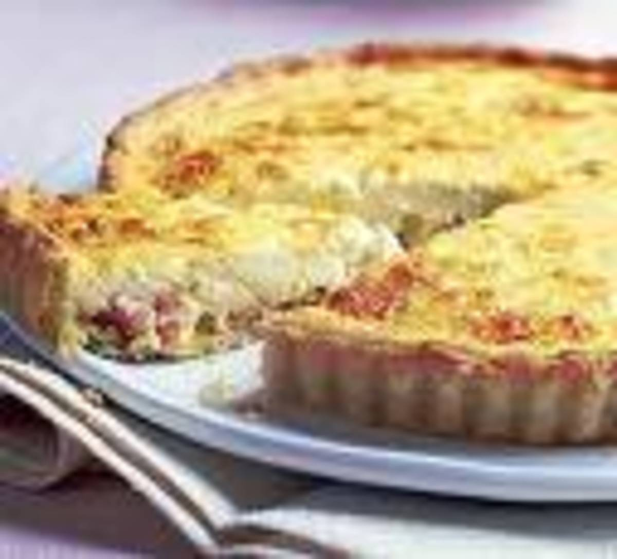 Hot Quiche is enlivened by chilli jam, serve with a crisp green salad. or