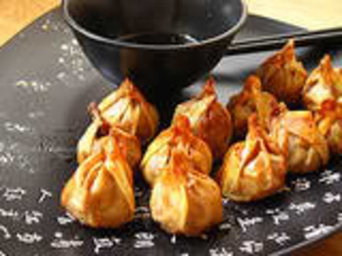 When I have them with Won Tons or Spring Rolls, I make sure a teaspoon or more of jam is already on the plate, Use a knife to smear on gently (won tons fall to pieces easily so be prepared to use your fingers!)