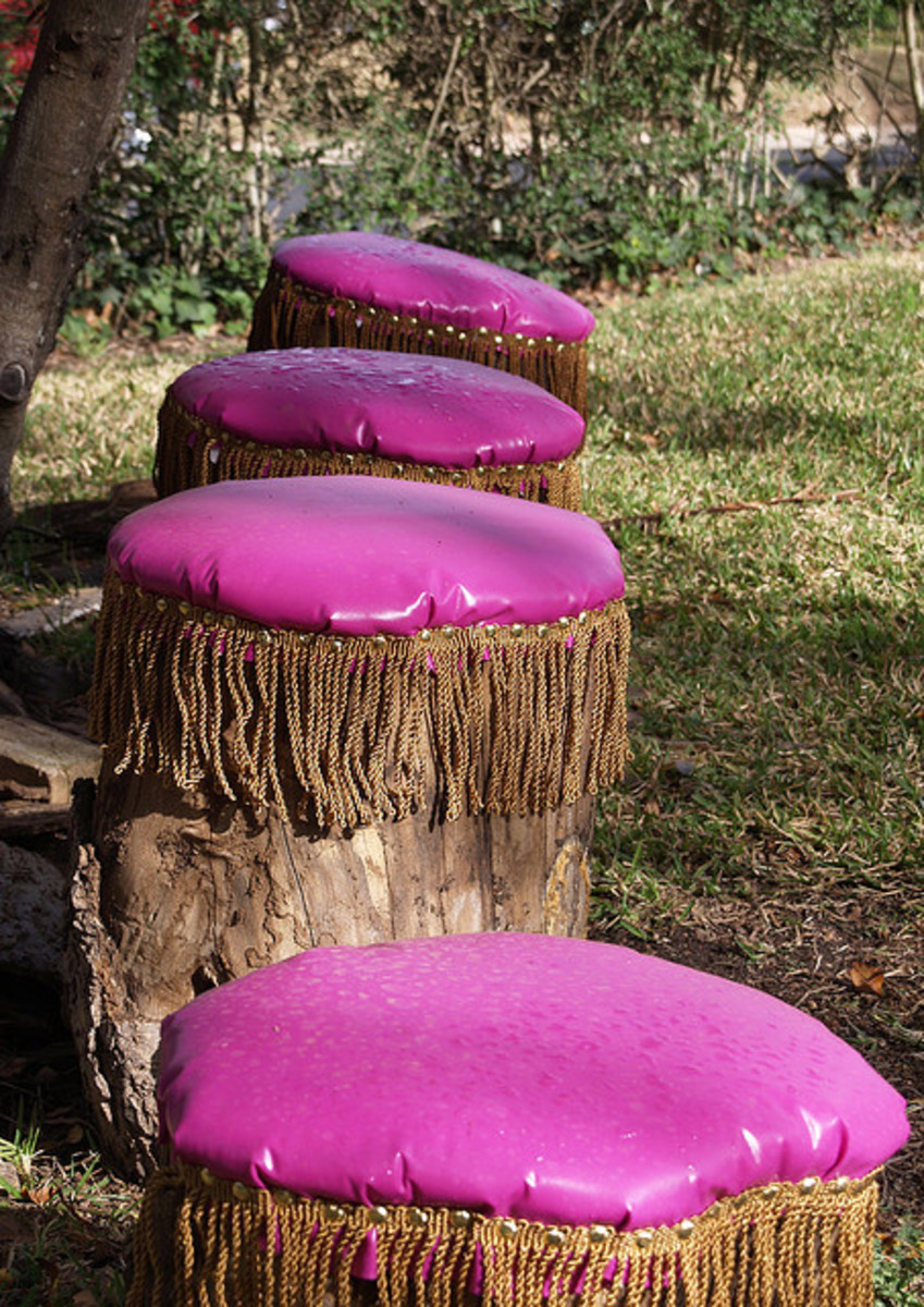 A fun idea for adding wipe-clean pink vinyl and some decorative trim to tree stumps!