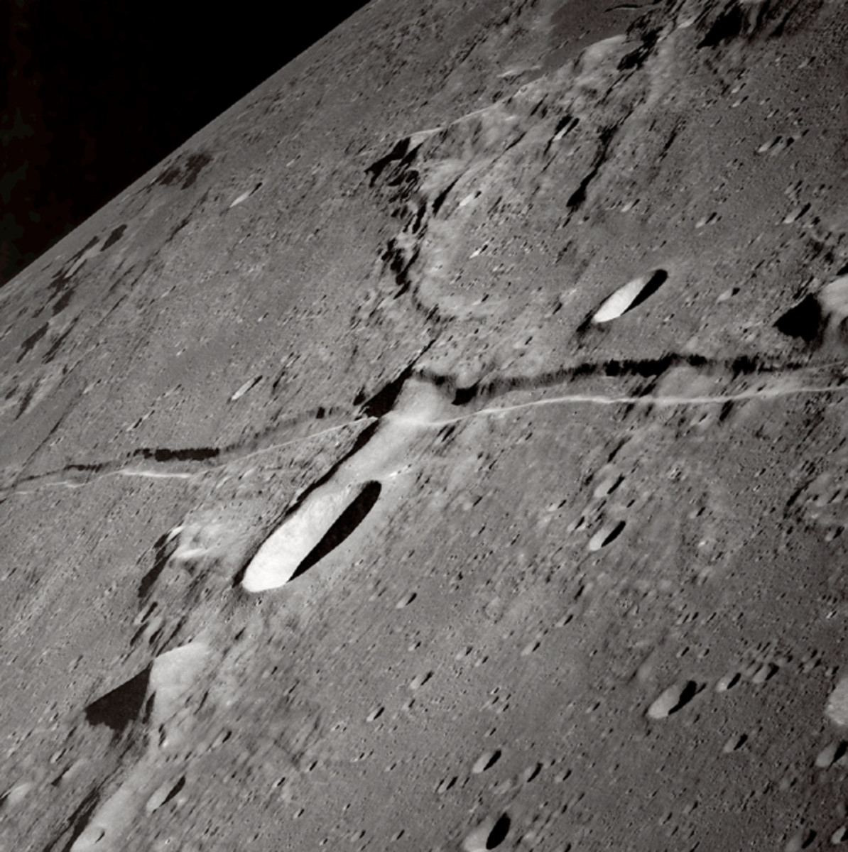 This is the cleft left behind after the Prophet Muhammad (pbuh) split the moon over 1400 years ago! Please copy and paste this link to see for yourself: http://apod.nasa.gov/apod/ap021029.html