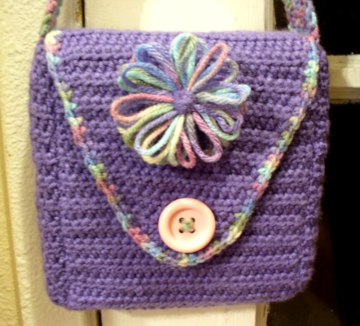 Crocheted Purse Embellished with a flower from a Knifty Knitter Flower Loom