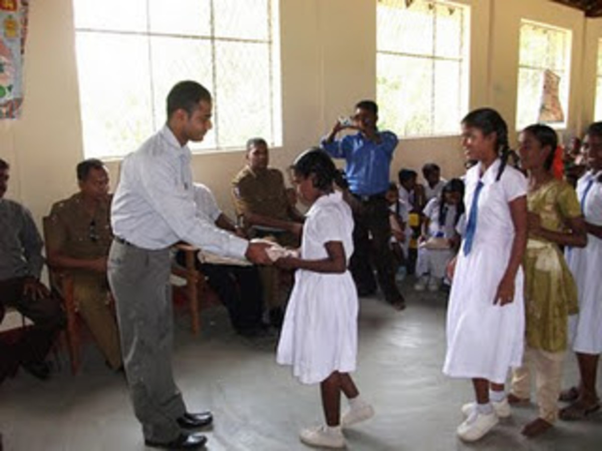 A donation program in remote area where students in their uniforms