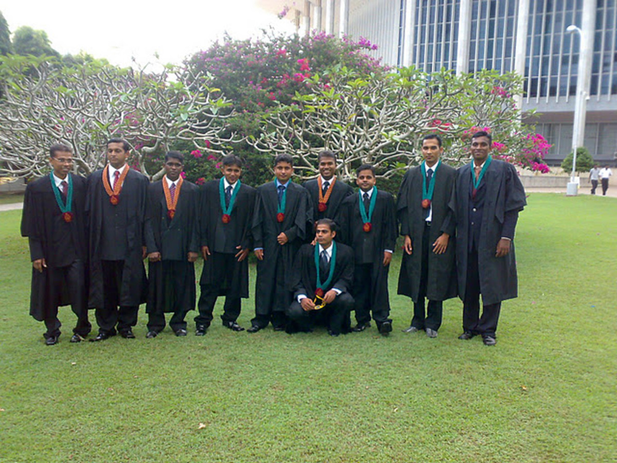 A set of Wayamba University graduates on their convocation. At BMICH. Myself is knelt down!