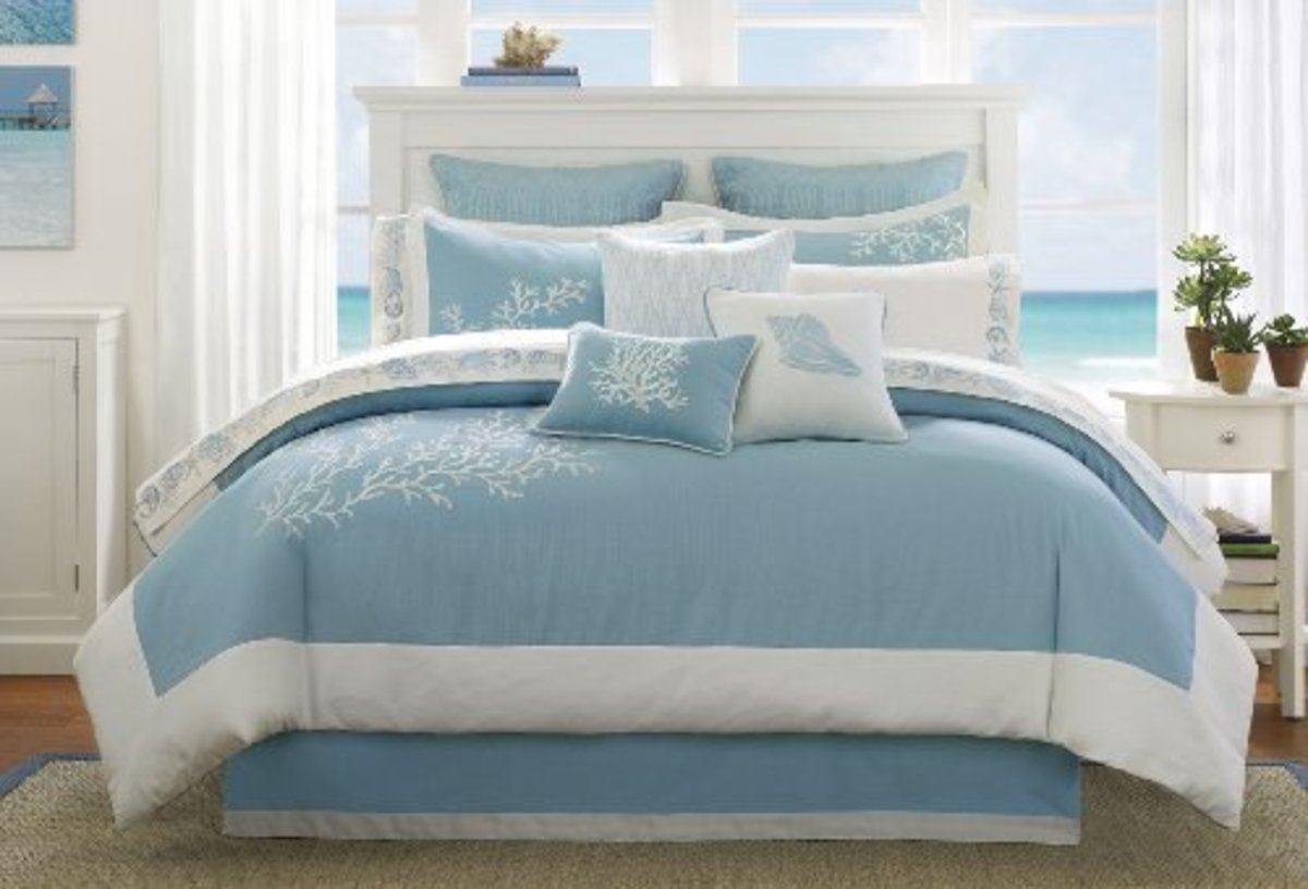 Azure makes us immediately envision skies and calm ocean waters. Matched with white trim brings the sparkle of light  and a clean edge to a comfy and inviting bed.