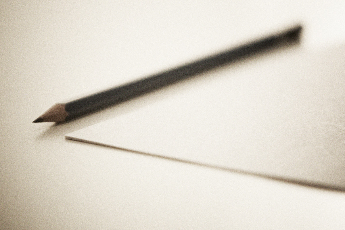 Sharpened Pencil next to a sheet paper, that is what you need to start playing. Image By Thomaseagle (Own work)