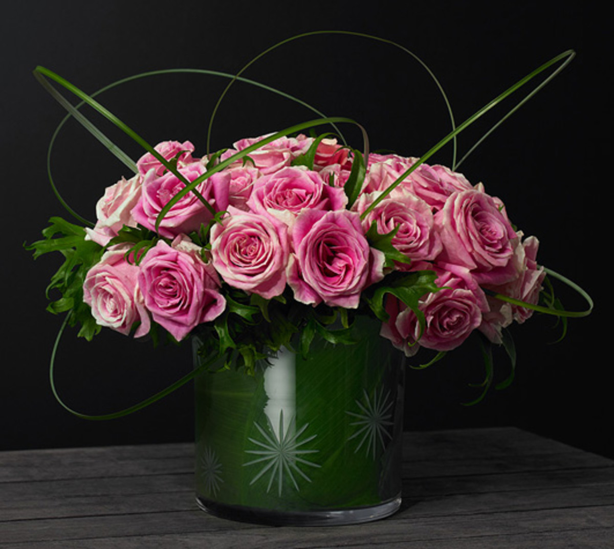 The photographer filled a Waterford crystal ice bucket with magnificent pink roses.