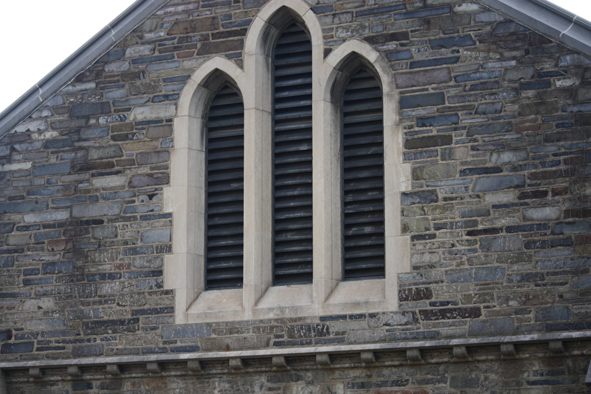 The upper windows of Whitman Hall.