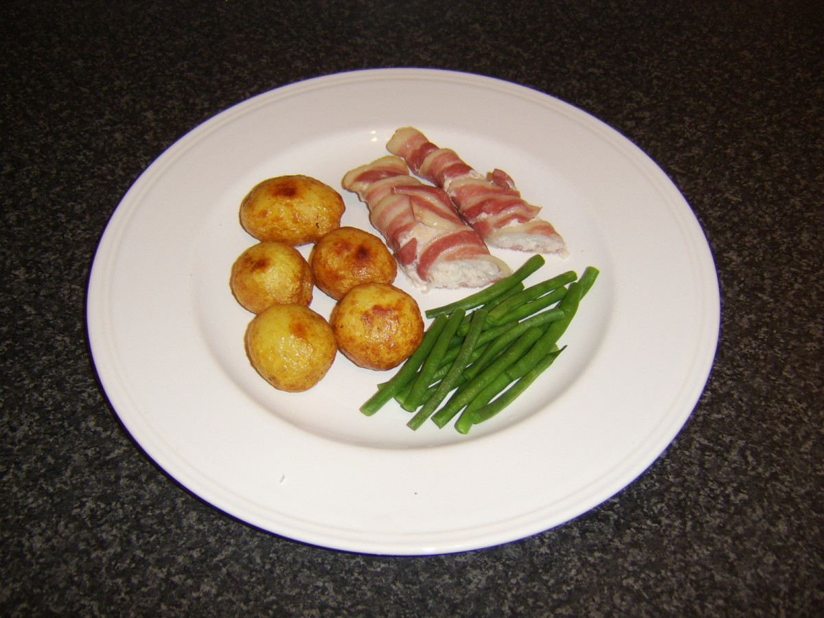The basa in this recipe has been wrapped in bacon before being oven baked