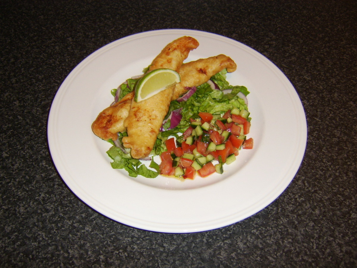 Basa fillets coated in batter and deep fried in oil