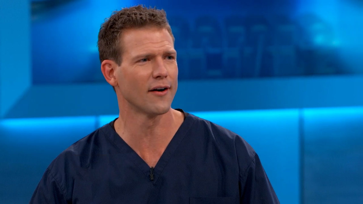 Dr. Travis Stork in scrubs.