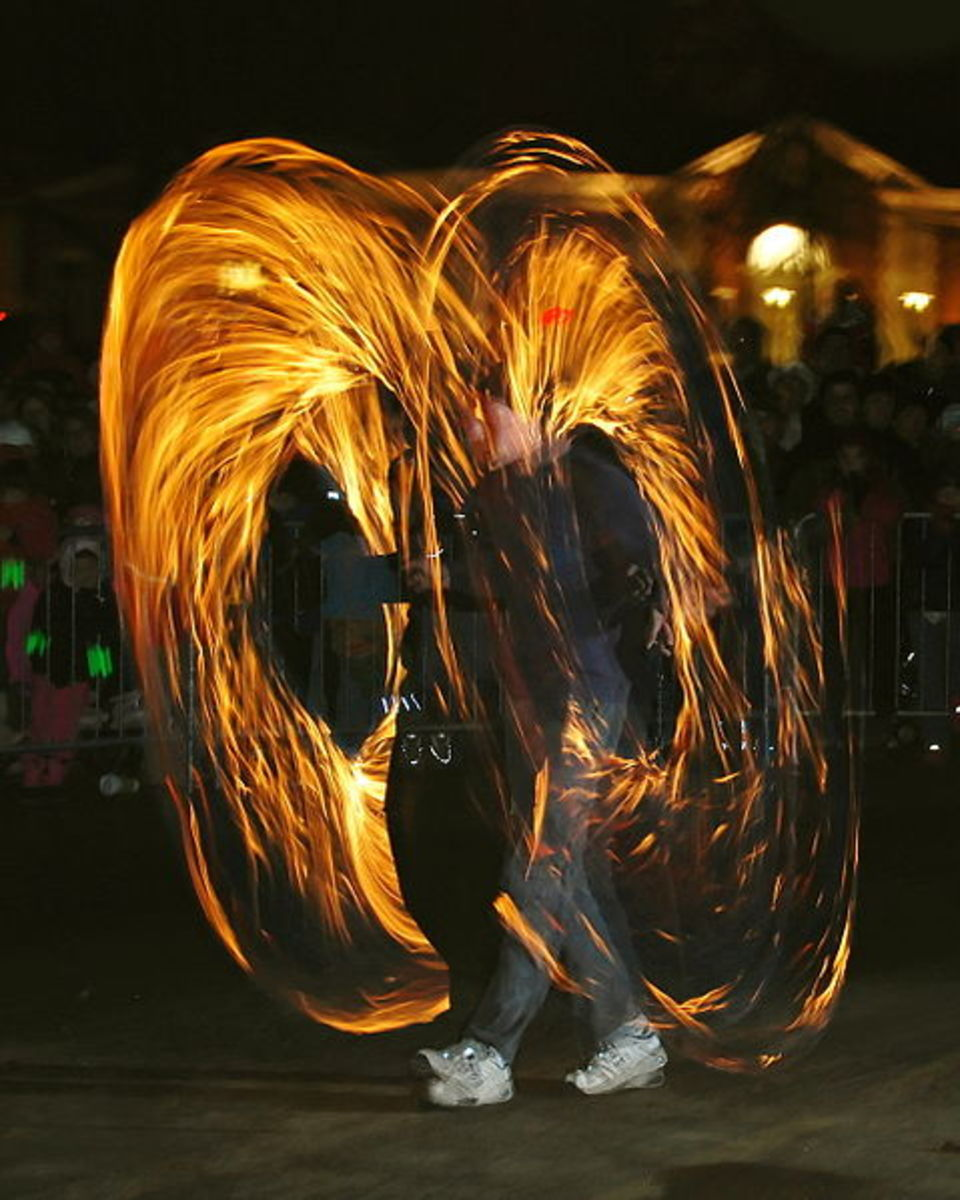 Poi is a form of juggling originated by the Maori people in New Zealand. This photograph of fire poi was taken by Paul Keleher on December 31, 2007.