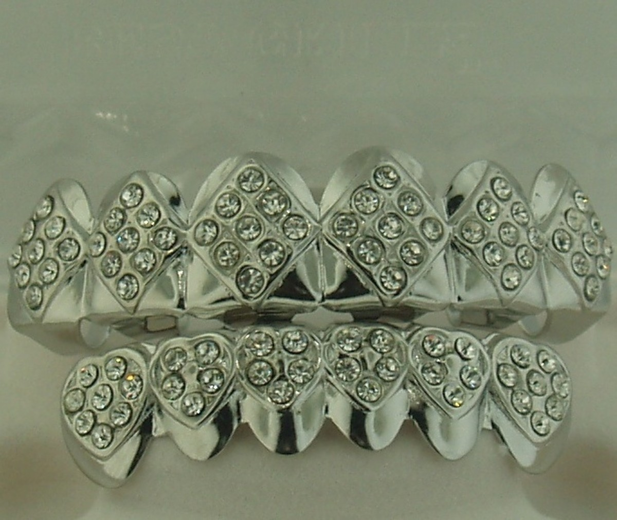 $24.99 silver-plated brass grillz