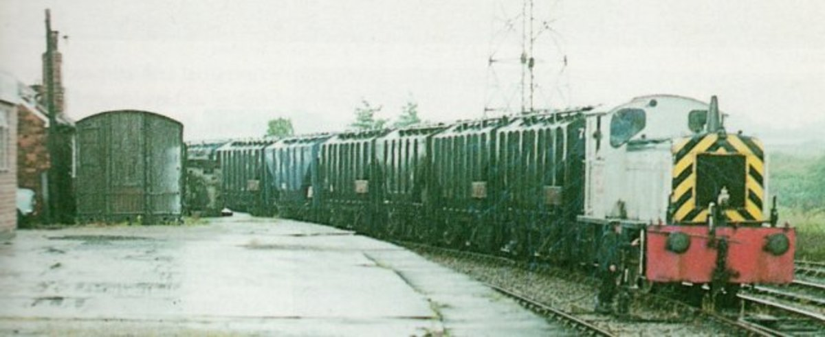 At Layerthorpe on the Derwent Valley Light Railway near York, an ex-ROD diesel shunter brings a train of bulk grain wagons for onward transit to distilleries in Scotland or cereal process (food products)