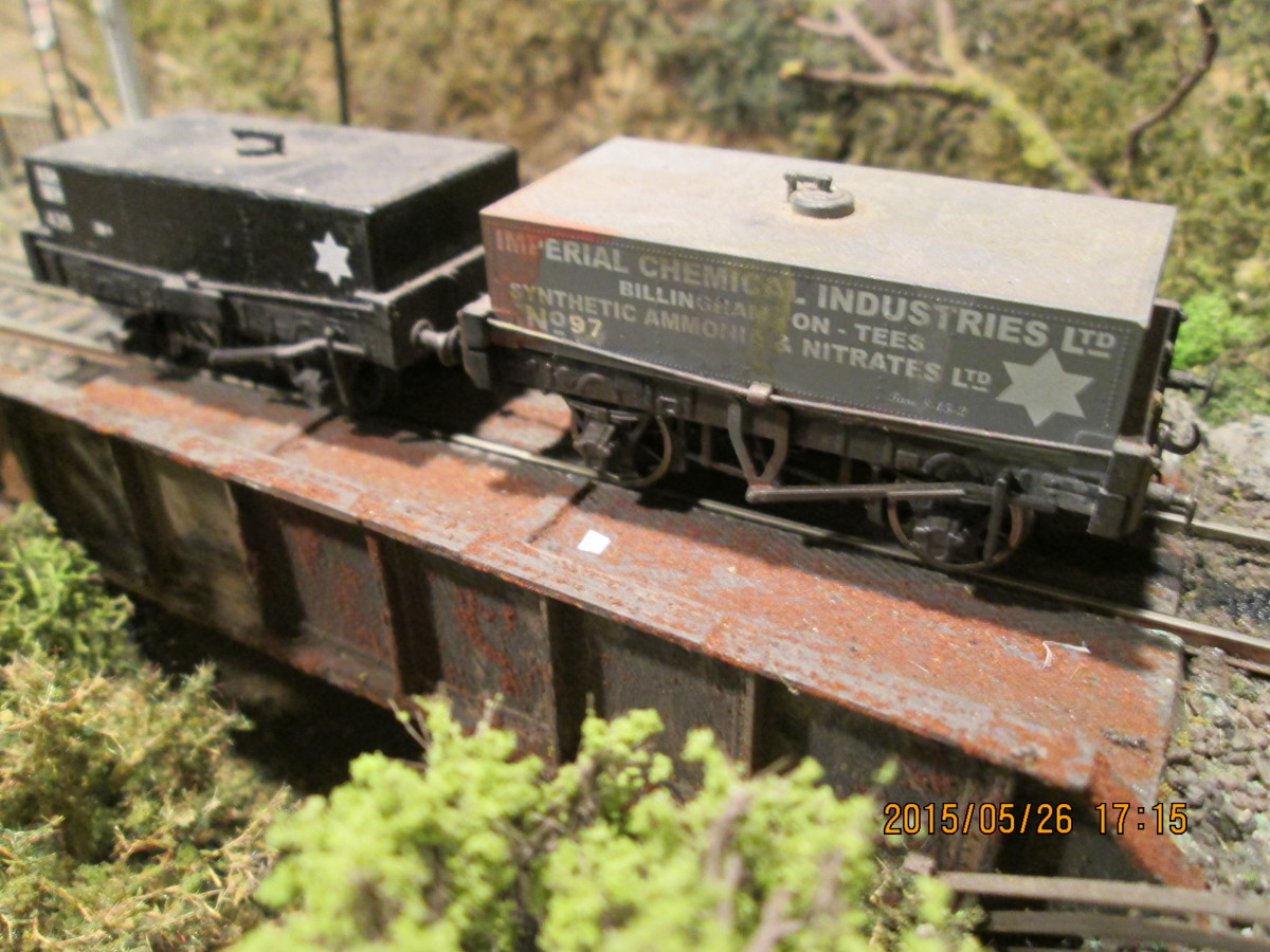 A pair of elderly tar wagons - this traffic would be largely road-borne before British Railways reached its fifth birthday (1953). The black one is a Slater's kit, the other is a Dapol product