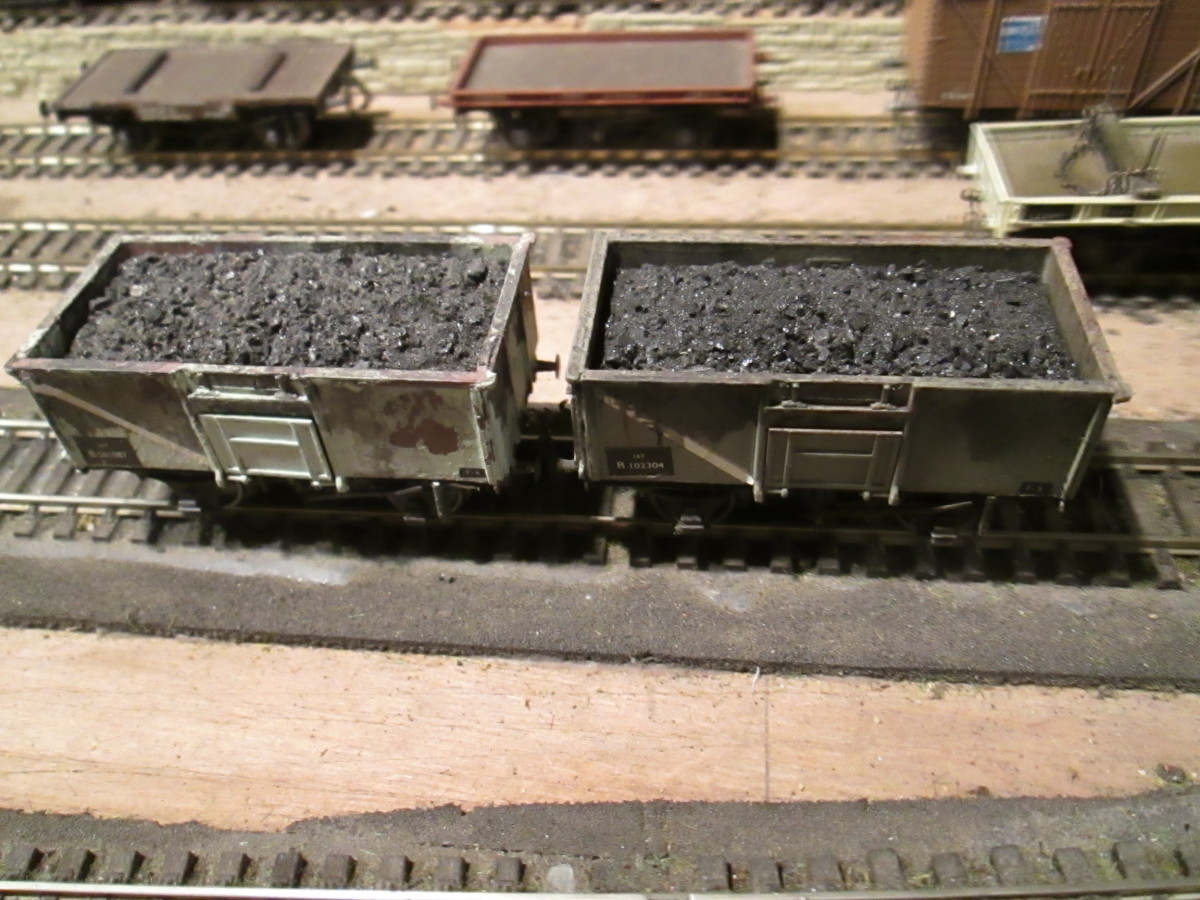 Early in British Railways days a new steel mineral wagon was built at various sites by BR and contractors to the 16 ton pattern to replace older 12 and 13 ton wooden wagons. (Dapol/ Airfix kits with removable coal loads, topped by real coal on pva)