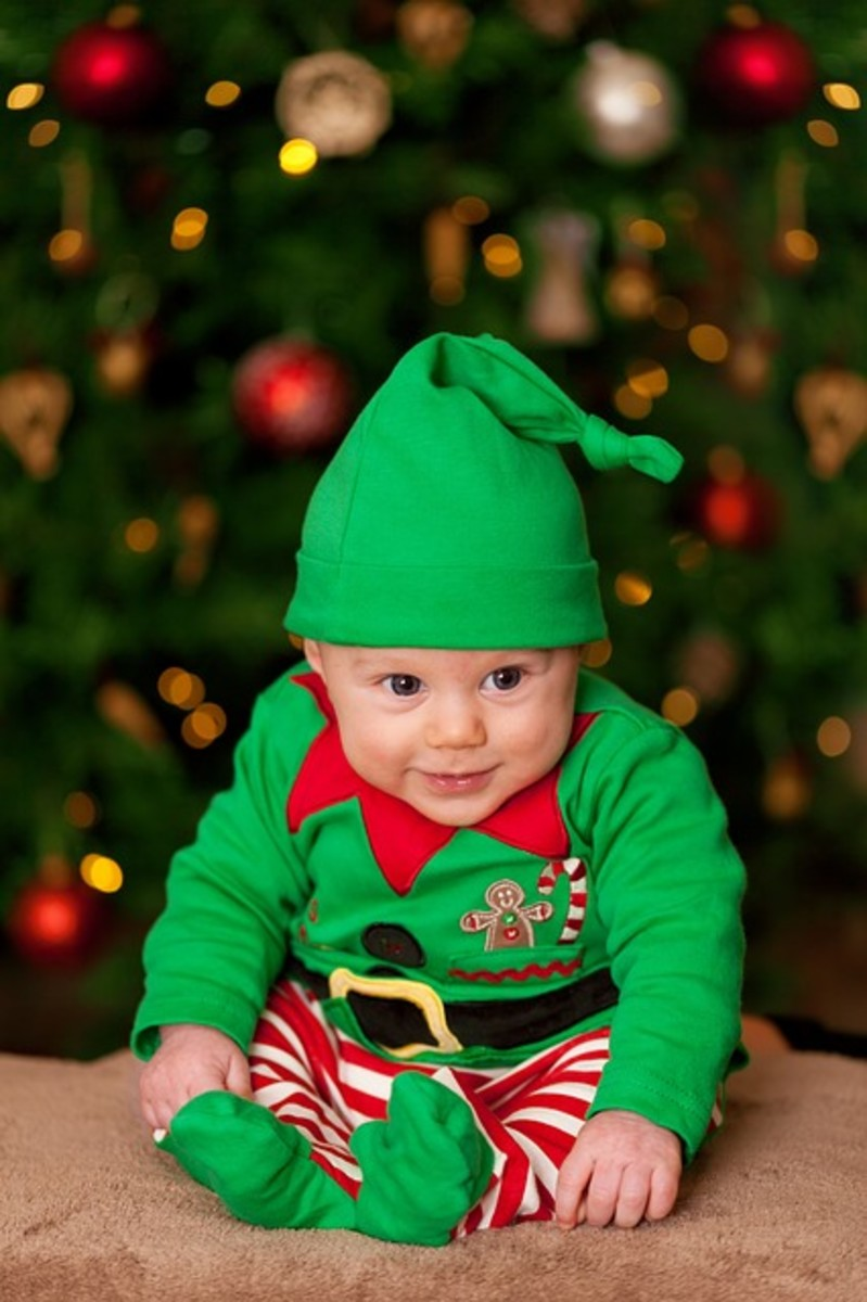 Baby boy in a little green elf outfit.
