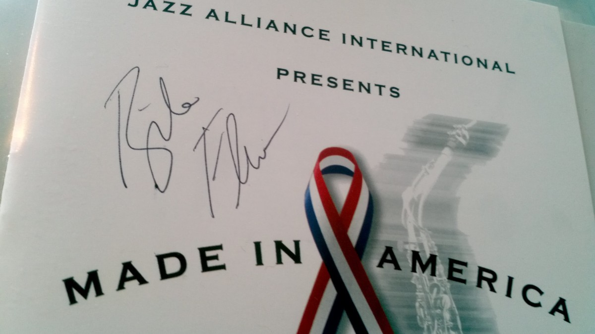 Program cover signed by jazz artist Bela Fleck (from NYC)  at a huge fundraiser at Town Hall (on December 5, 2001).