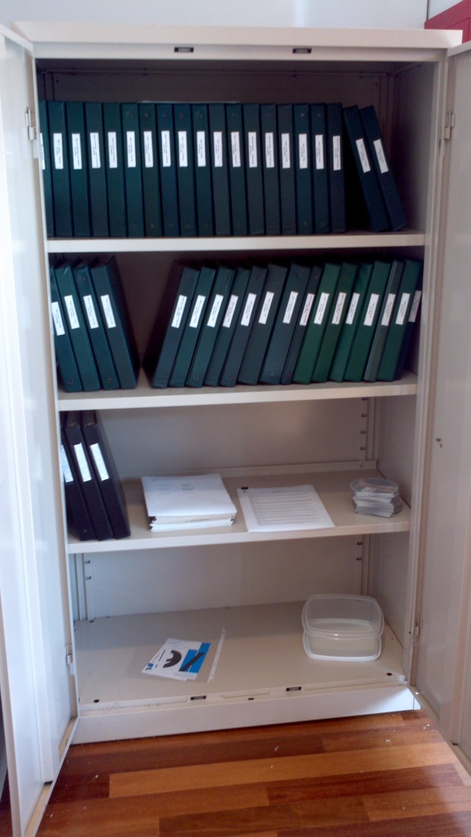 This is the opened shelving unit exposing my entire collection, kept in binders in the same chronological order I gathered everything, and opened when visitors wanted to check out certain dates.