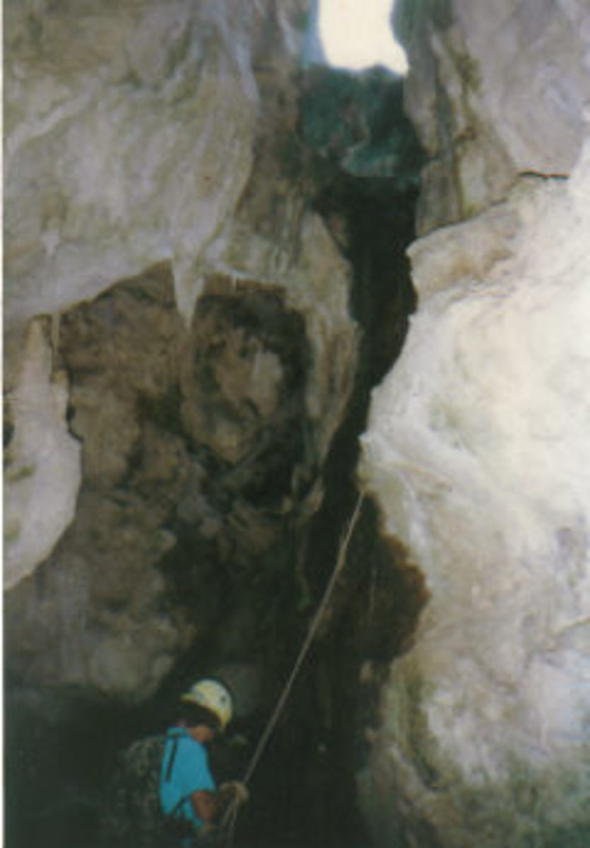 Rappel inside Christmas Tree Cave.