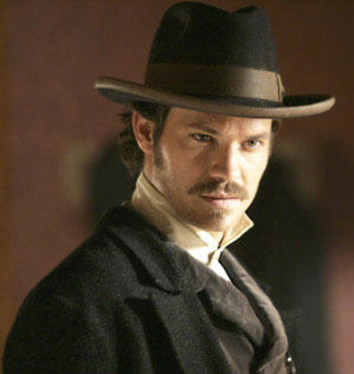 Timothy Olyphant (there are better pictures of him that prove my point, but in this one he is wearing period clothes and has a mustache. I couldn't resist).