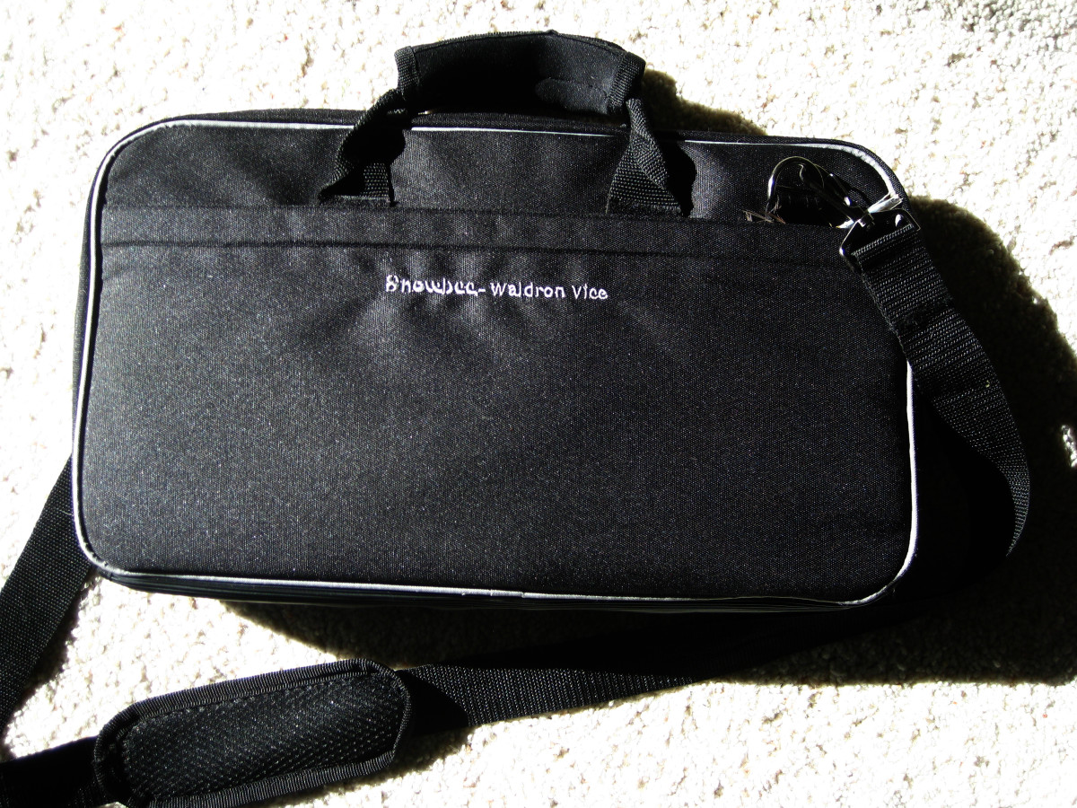 The soft padded multi-compartment carrying case is included with the vise.