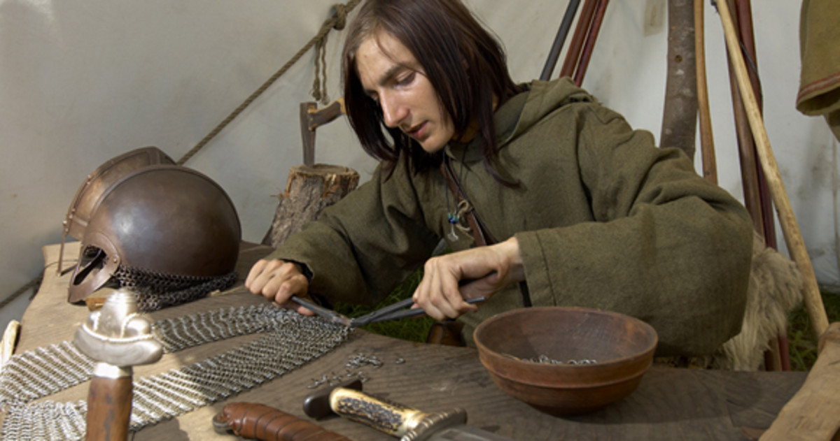 Weaponmaster at work on chain mail - Viking Centre, Ribe, western Jutland (Denmark)