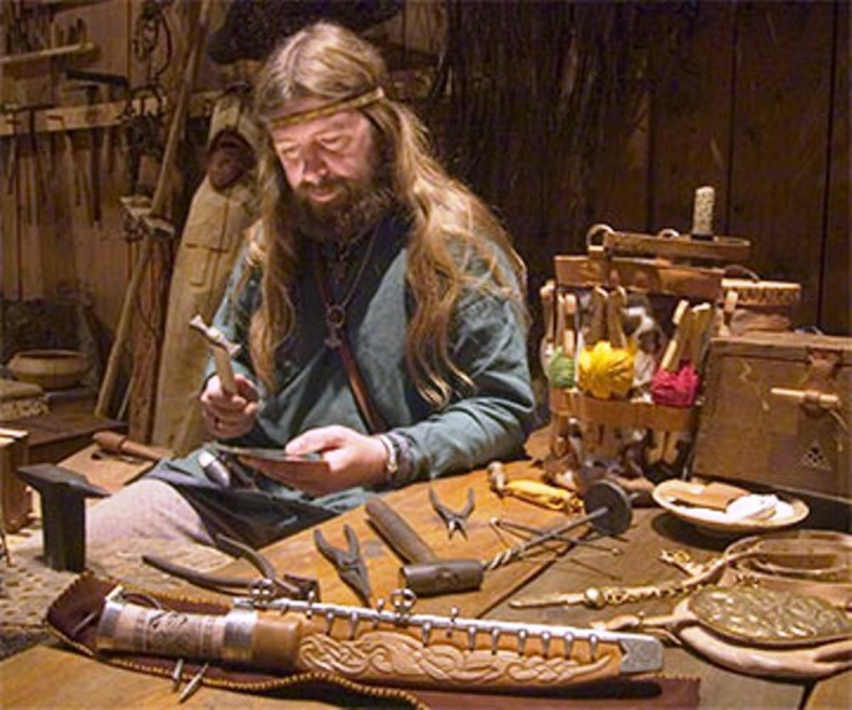 Modern-day weapon-maker, a master craftsman in his workshop busies himself with a task to reproduce a Viking Age sword