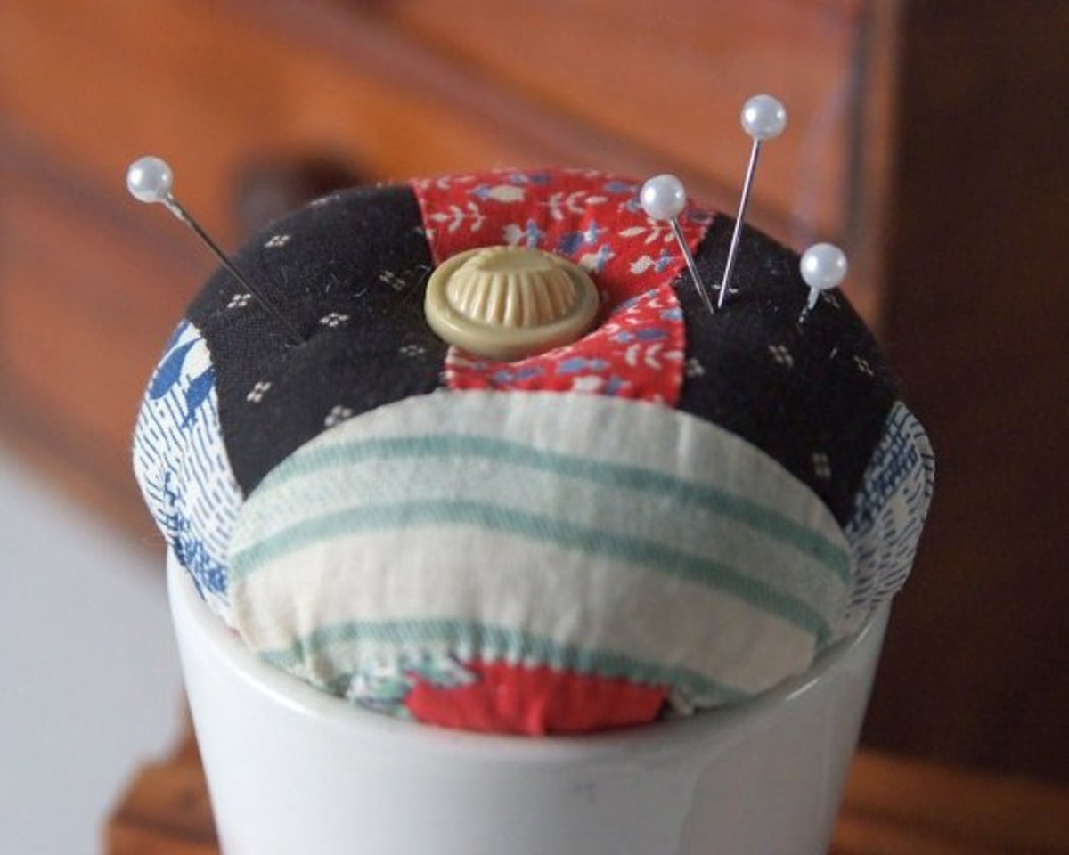 Farm house quilted pin cushion. Photo courtesy of TheEccentricLady on Etsy.