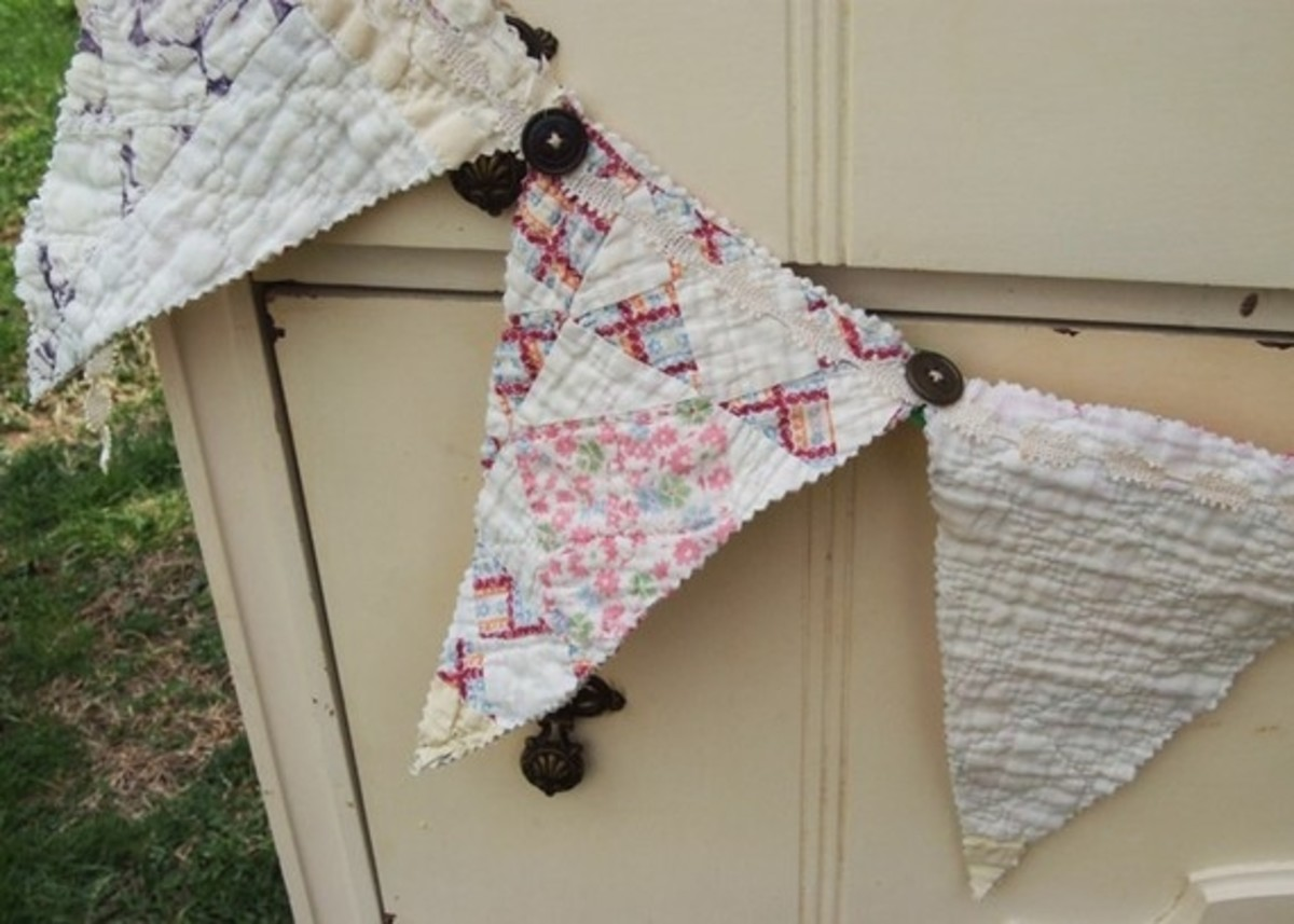 Quilted banner with vintage lace and buttons. Photo courtesy of TheEccentricLady on Etsy.