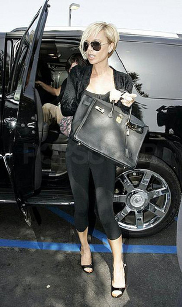 Posh spice with the classic black Birkin