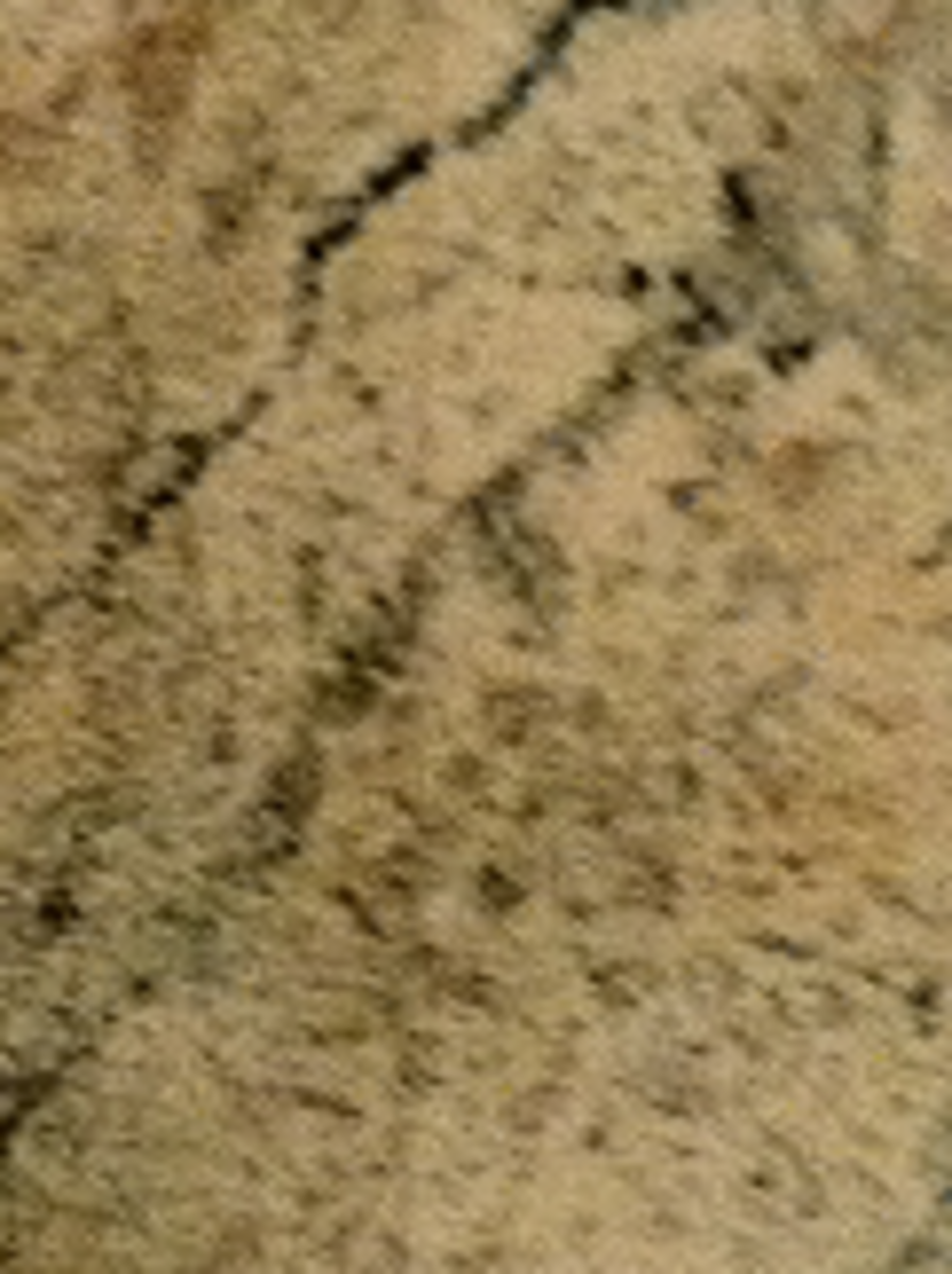 This picture shows the (essentially invisible) seam where I joined the wallpaper on the top side of the table