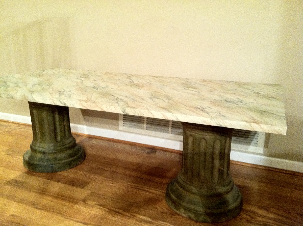 The Finished Faux Stone Coffee Table Sitting on Two Bases