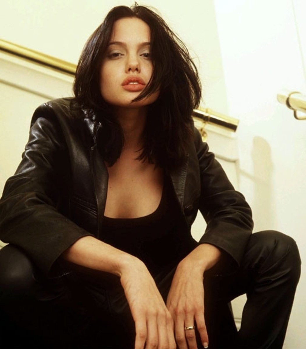 A young Angelina dressed all in black.