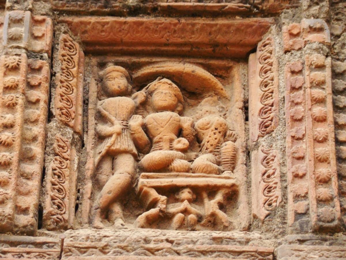 Terracotta art in Supur Twin Temples 7 (Lord Rama , Sita Devi, Lakshmana with Hanuman peeping from below the throne)