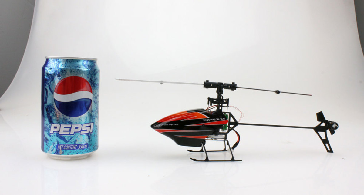 Here's the WLToys V922 next to a can of 12 oz Pepsi... Yes, it's that small, and yes, it's a full 6 CH bird.